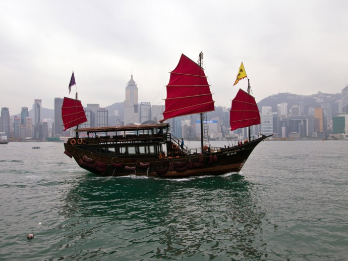 A traditional junk in front of the skyline of Hong Kong Island