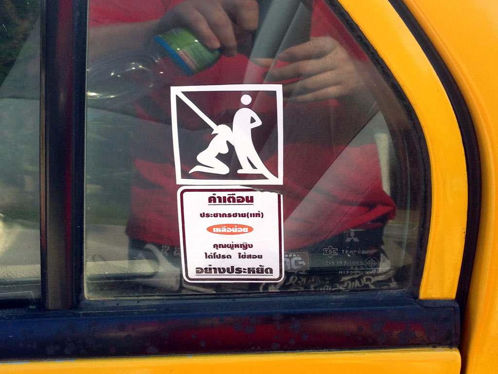Prohibition sign on a taxi in Read Below Sign