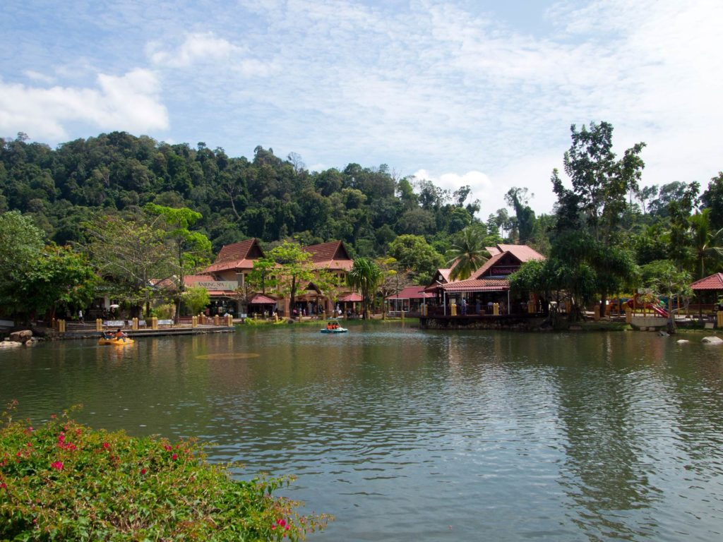 A lake with paddle boats in the Oriental Village on Langkawi