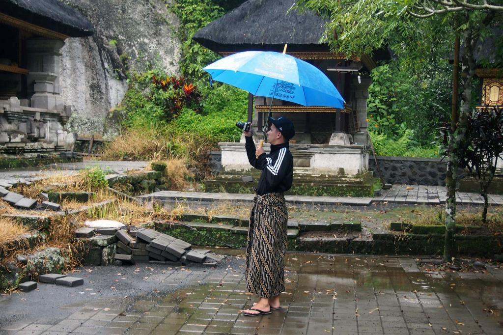 Marcel with an umbrella on Bali