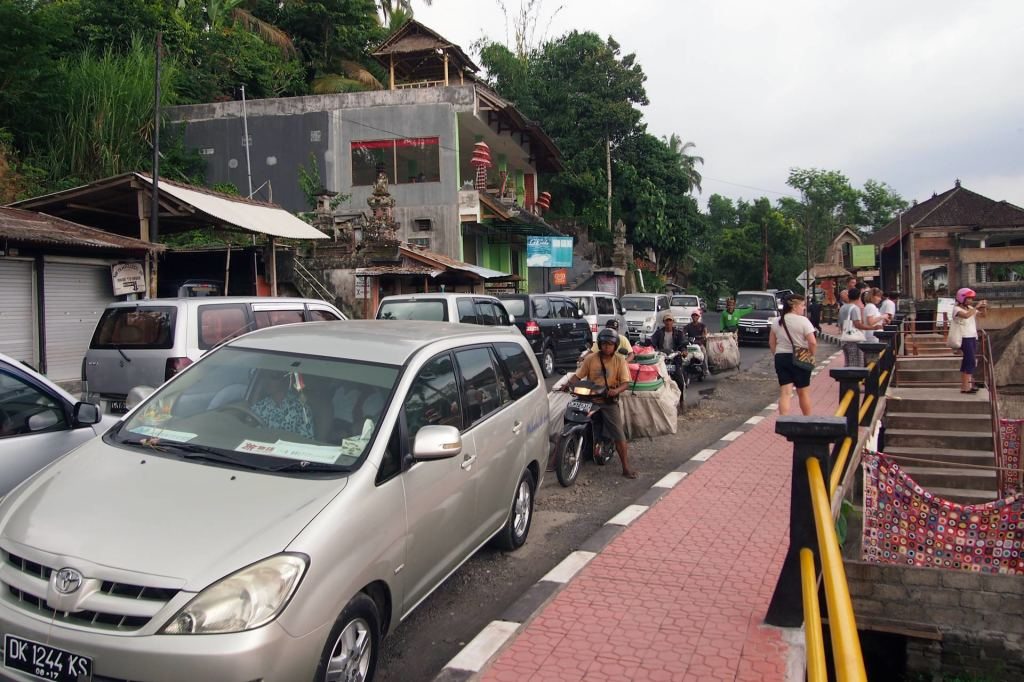 Totally crowded street on Bali in front of the rice terraces of Tegalalang