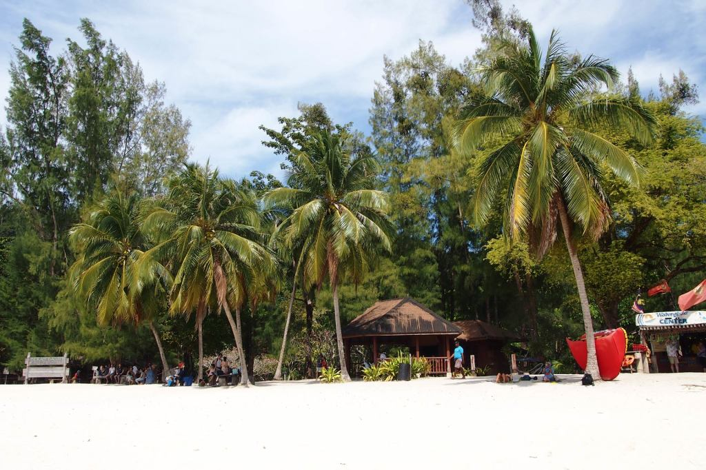 Small shops and huts at the beach of Pulau Beras Basah