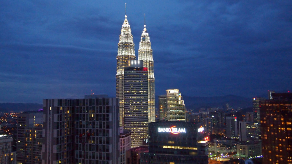 The Petronas Towers. Seen from the Menara KH at the blue hour