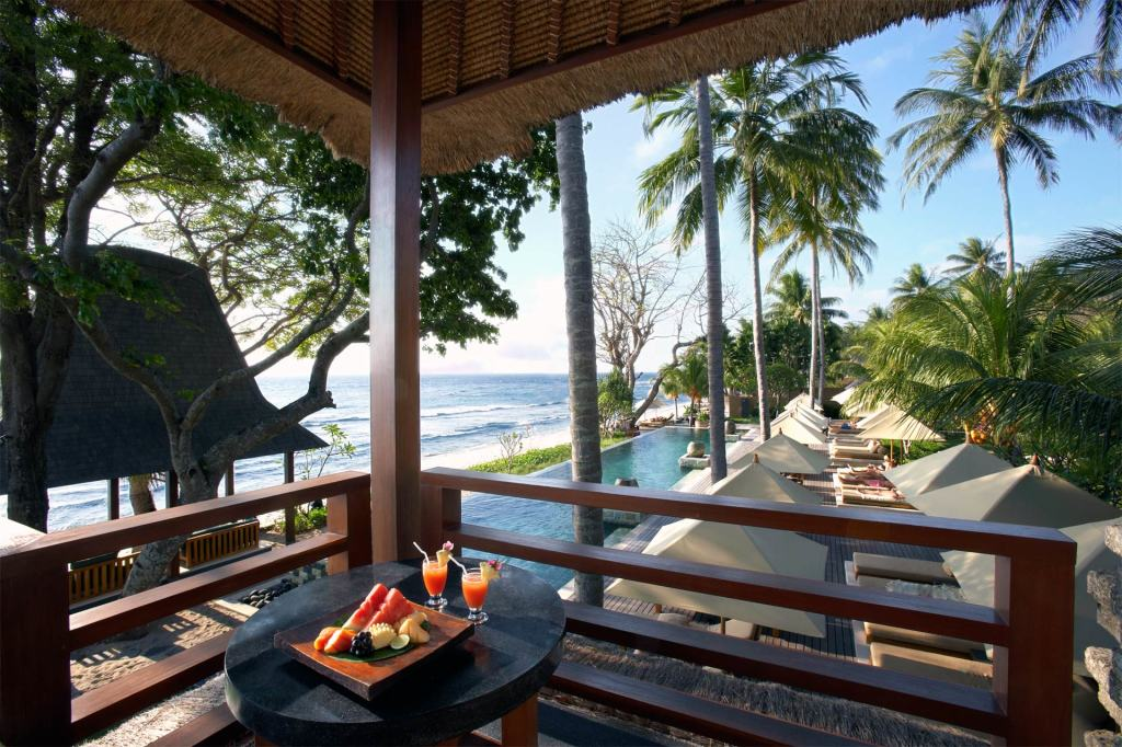 Room with pool and ocean view at Qunci Villas, Lombok