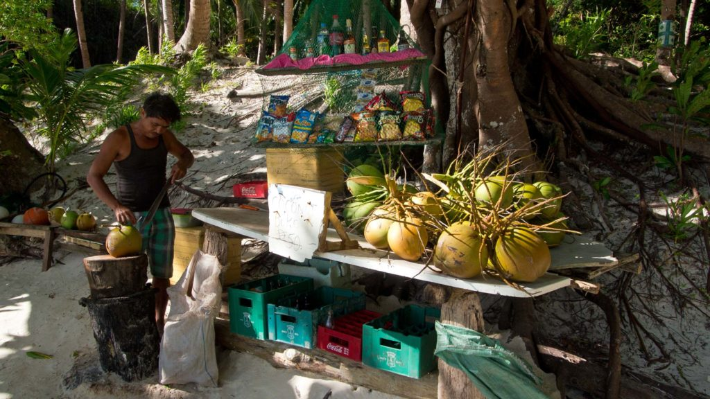 The coconut vendor at Papaya Beach