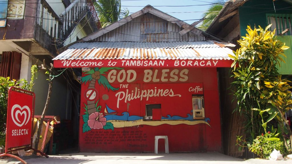 Small hut on Tambisaan Beach with 'God bless the Philippines' inscription
