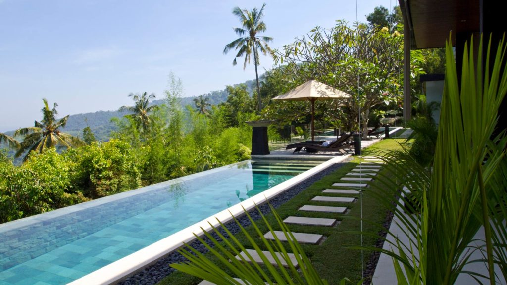 Outdoor area and the infinity pool of The Puncak