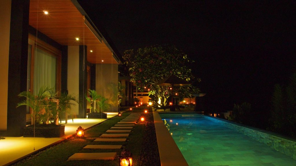 Outside and pool area of The Puncak at night
