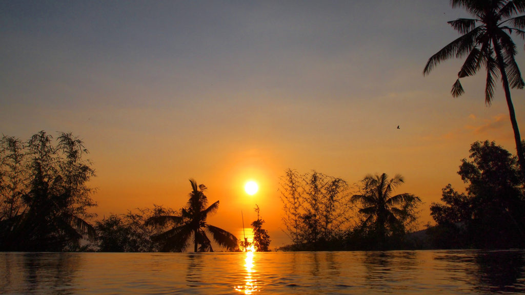Sunset at the infinity pool of The Puncak