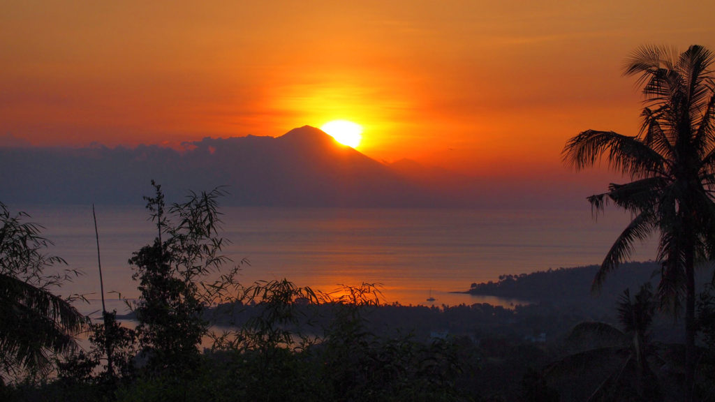 Sunset with view at Senggigi Beach and the Mount Agung on Bali