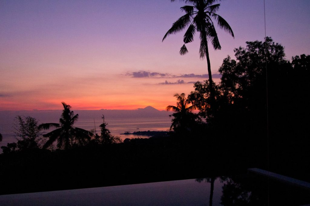 An amazing sunset with view at Senggigi Beach and the Mount Agung on Bali