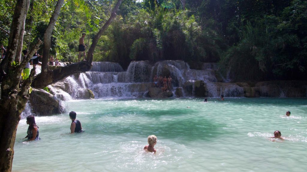 Many visitors at the large turquoise natural pool of the Tat Kuang Si