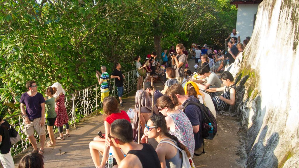 Many visitors at sunset on the Mount Phou Si