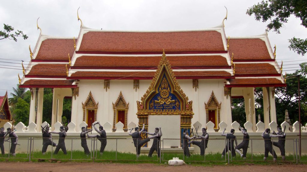 A temple building with fighters at the Wat Bang Kung, Amphawa