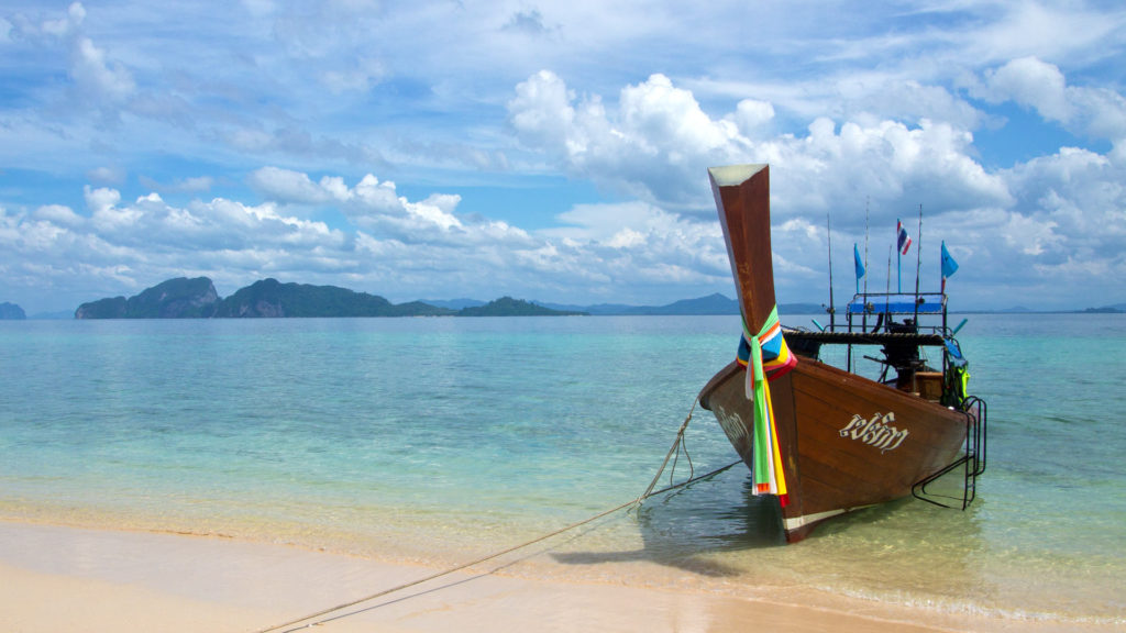 A longtail boat at the Paradise Beach of Koh Kradan