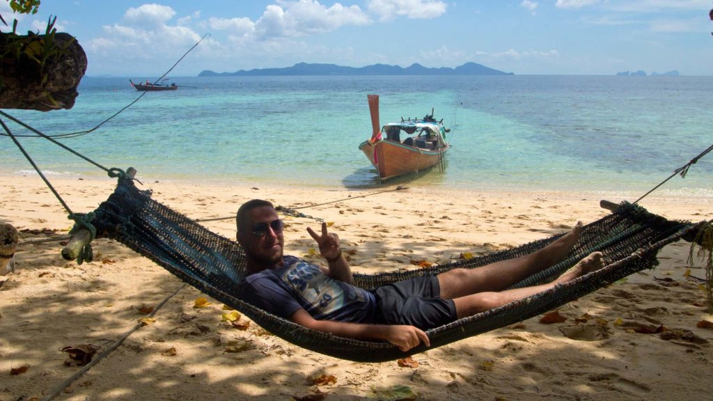 Tobi in a hammock on the Sunset Beach of Koh Kradan