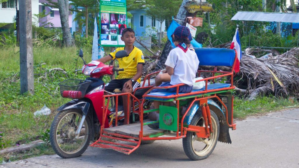 A child as a taxi driver on Koh Mook, Trang