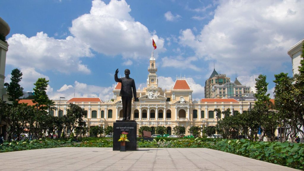 The old city hall with the statue of Ho Chi Minh, Vietnam