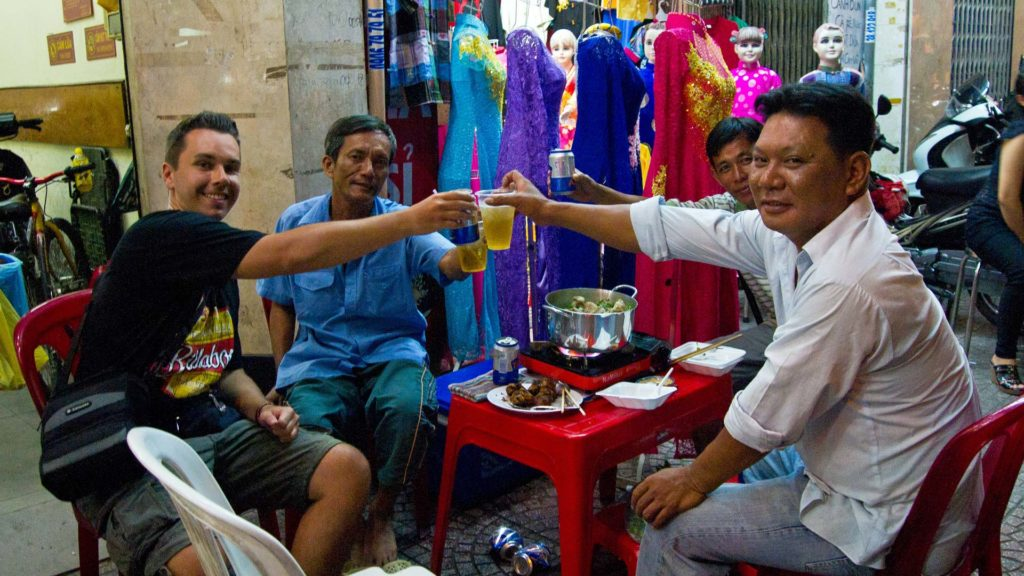 Locals eating and drinking with Marcel on the streets, Ho Chi Minh City