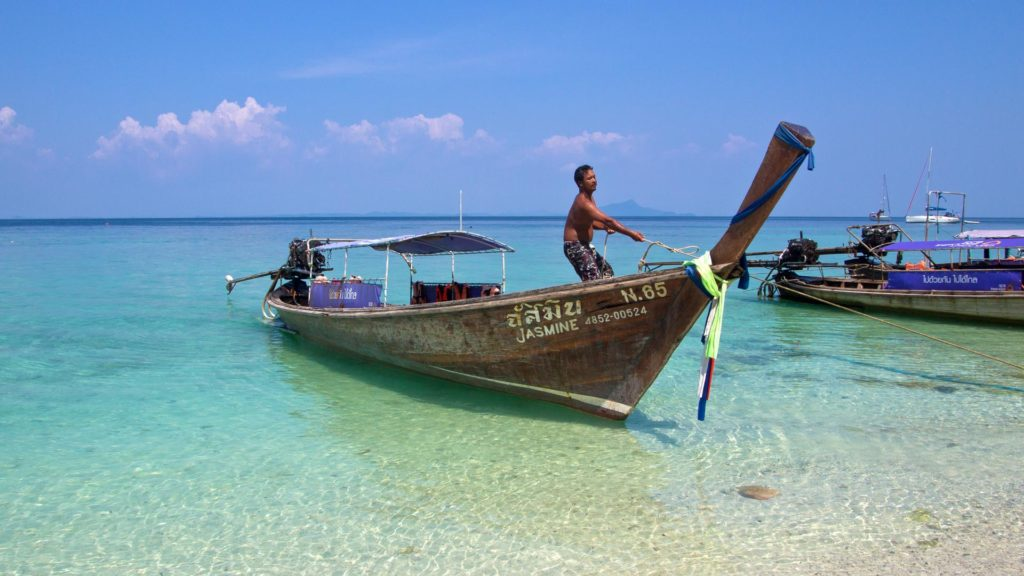Longtail boat at the beach of Chicken Island