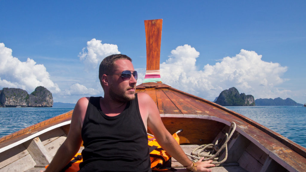 Tobi on a longtail boat on the way back to Koh Mook