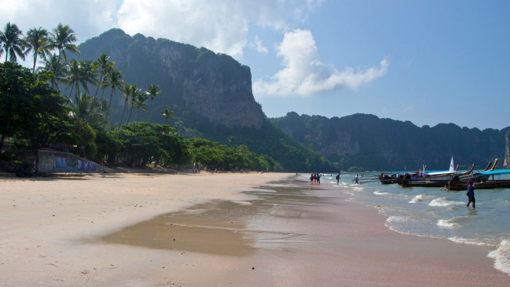 The Ao Nang Beach with a view at the huge limestone cliffs of Ao Nang, Krabi