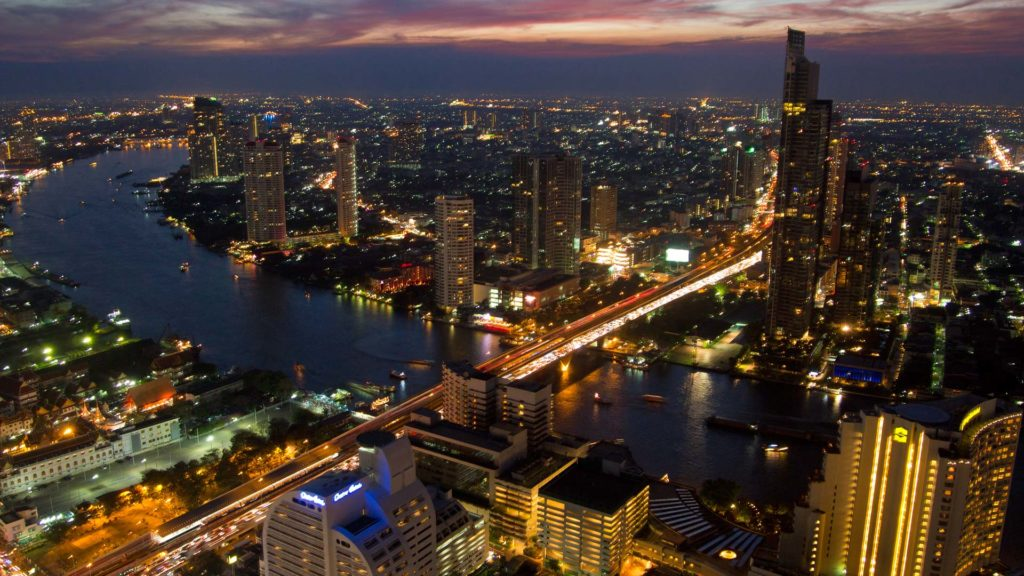 View of Bangkok from the Lebua at State Tower across the Chao Phraya River at night