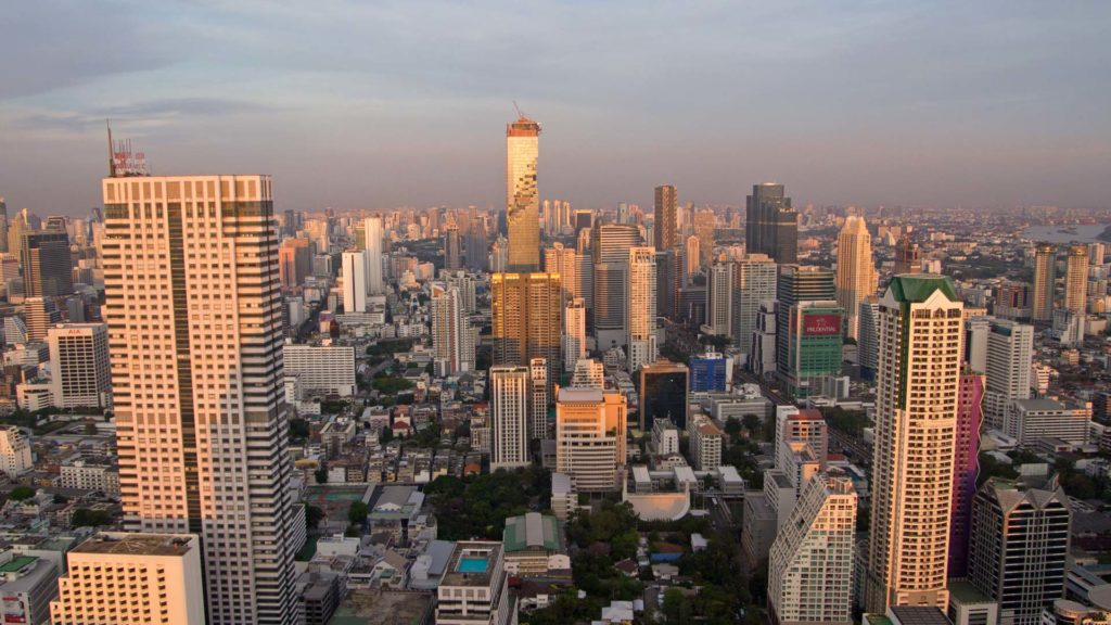 The high-rise buildings of Bangkok illuminated by the sunset