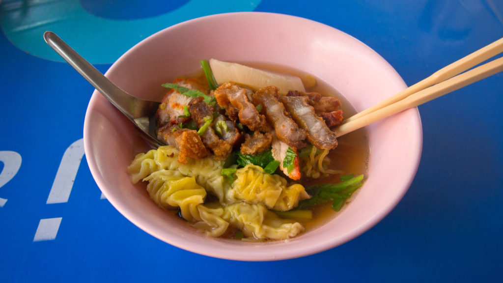 Bami Kiau Moo Grop - clear soup with yellow noodles, wonton and crispy pork
