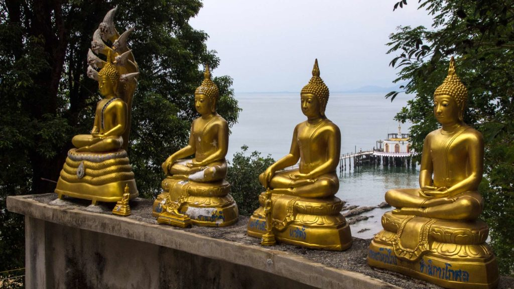 Golden Buddha statues and views from the Big Buddha to the temple pier of Koh Phayam