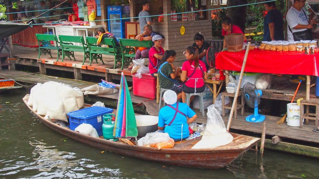 Vendors in a boat at the Taling Chan Floating Market in Bangkok