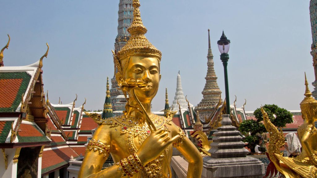 Statue with Chedis in the background in the Wat Phra Kaeo in Bangkok