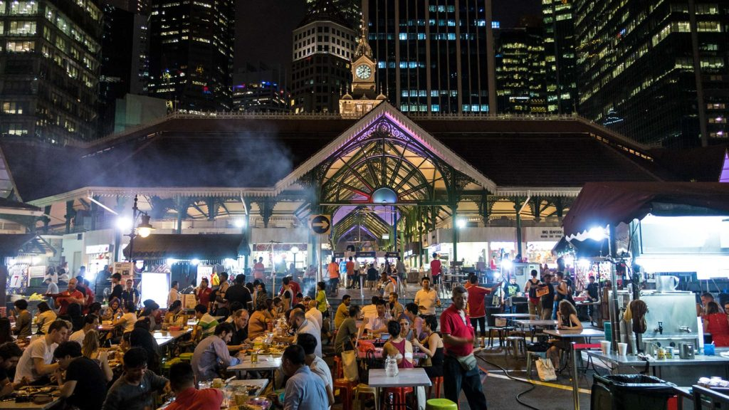 The fascinating Lau Pa Sat Hawker Centre between the skyline of Singapore