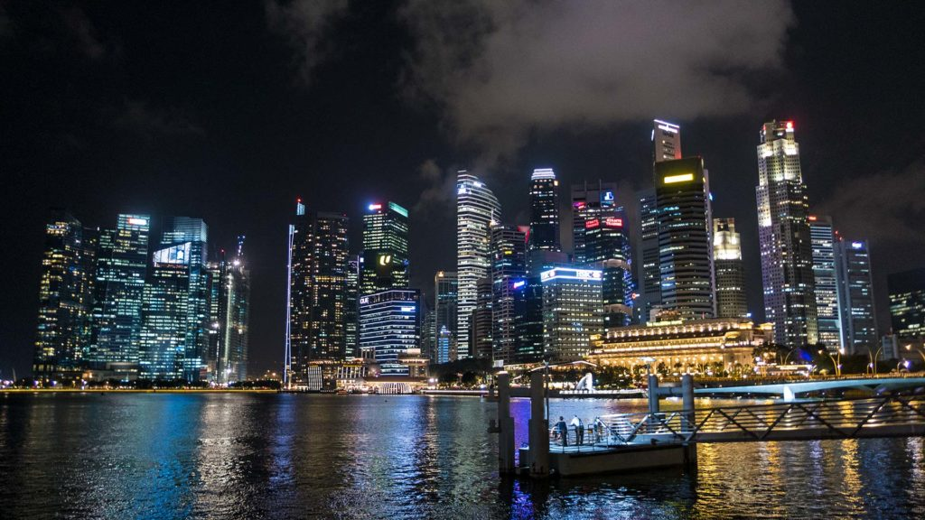 The view from the Marina Bay at the skyline of Singapore at night