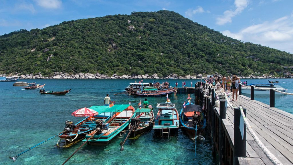 The pier on Koh Nang Yuan with lots of longtail boats