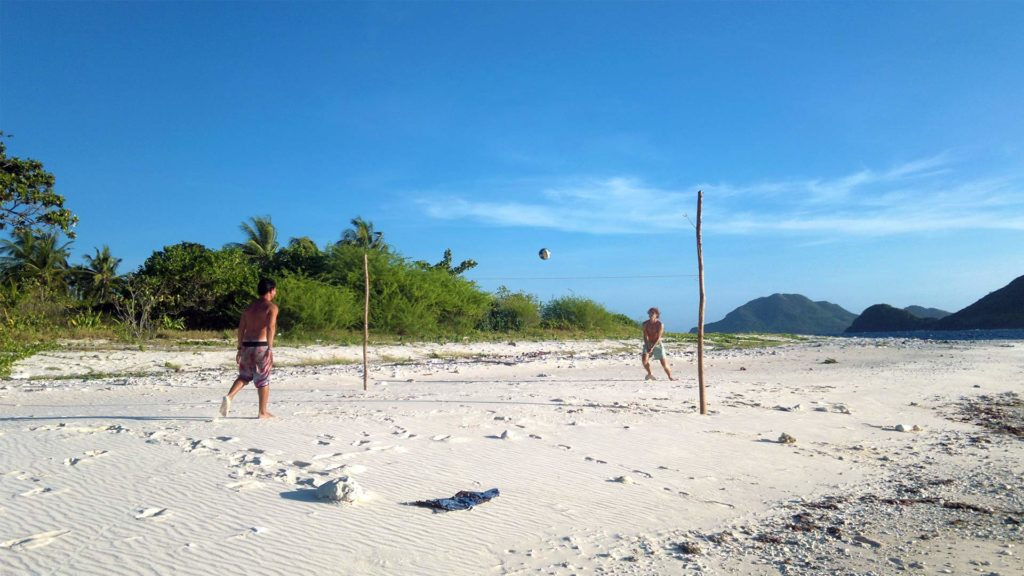 Guests playing beach volleyball on Dimancal Island in Linapacan