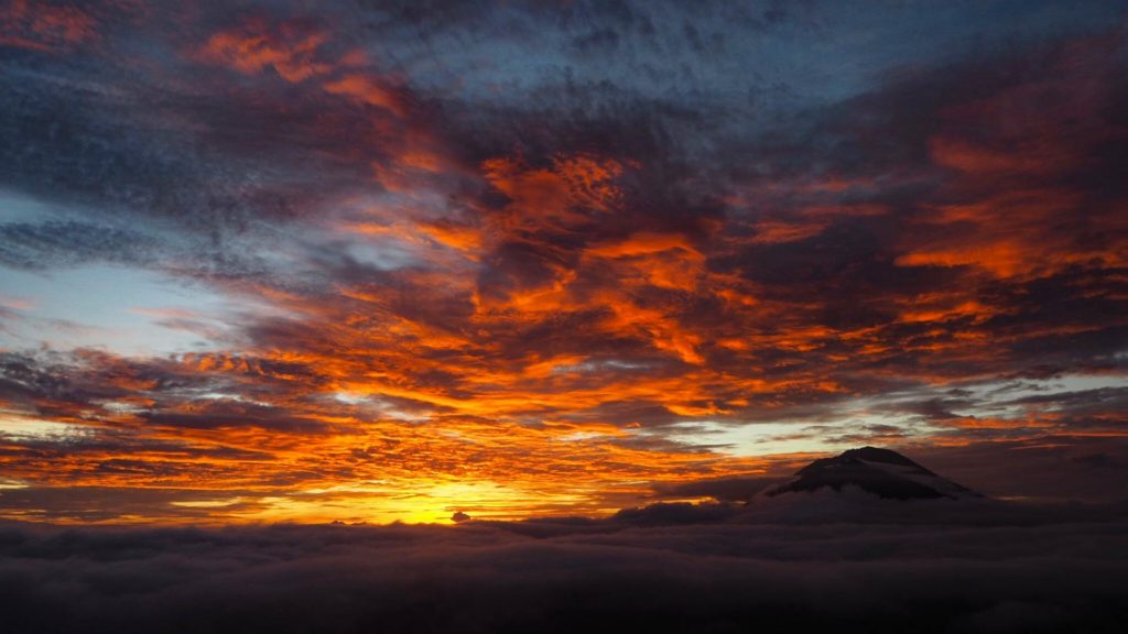 Red sky at a beautiful sunrise at Mount Batur, Bali