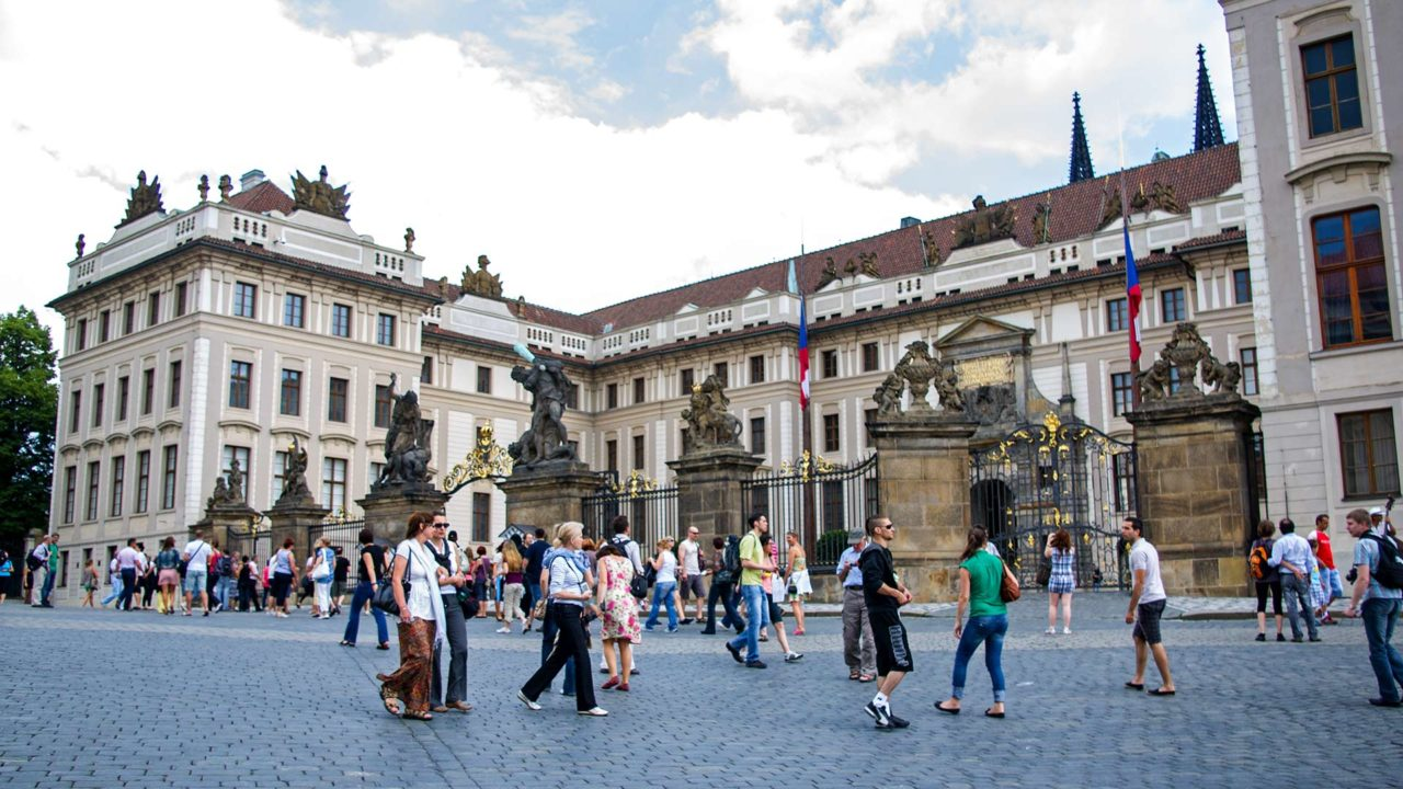 Tourists in front of the Royal Palace of Prague