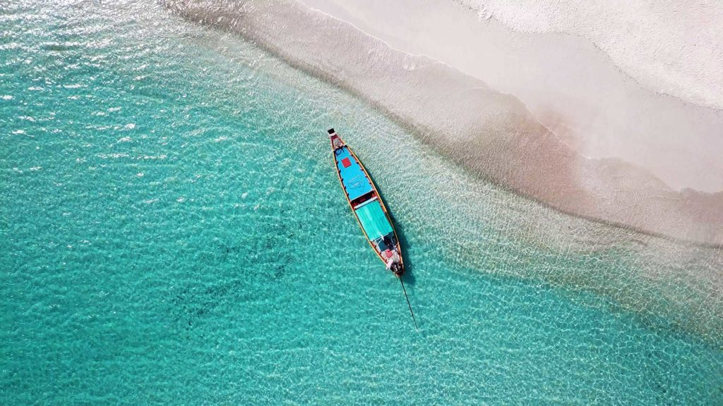 Longtail boat shot with a drone on Bottle Beach