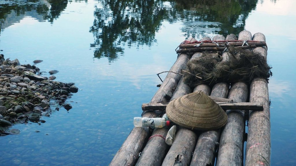 Bamboo raft on the river, Xingping