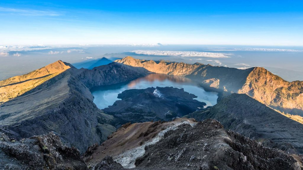View from the summit of Mount Rinjani to the crater lake Segara Anak and Bali