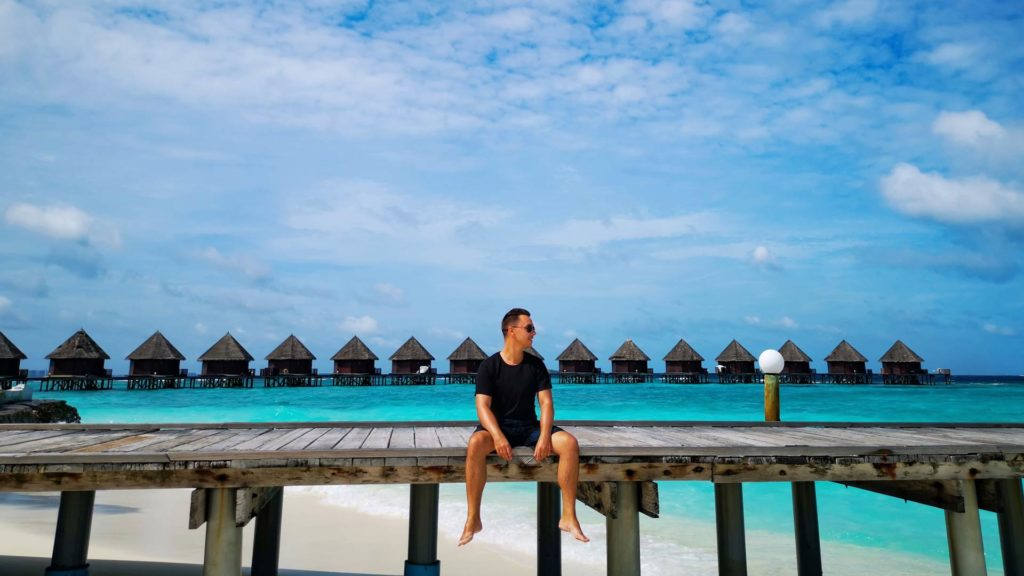 Marcel and the water villas from Thulhagiri Island Resort in the background