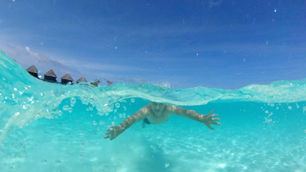Marcel swimming in the turquoise waters of the Maldives (taken with the GoPro and a dome)