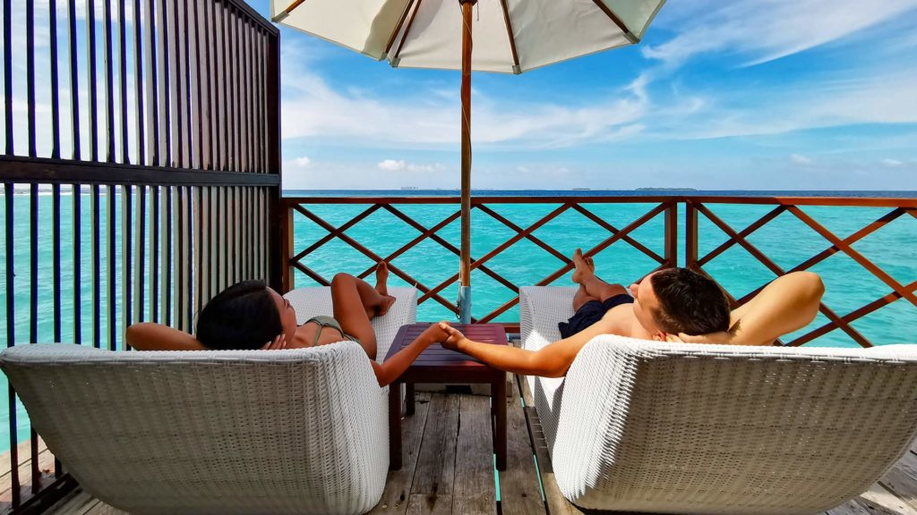 Marcel and wife in one of the water villas at Thulhagiri Island Resort, Maldives