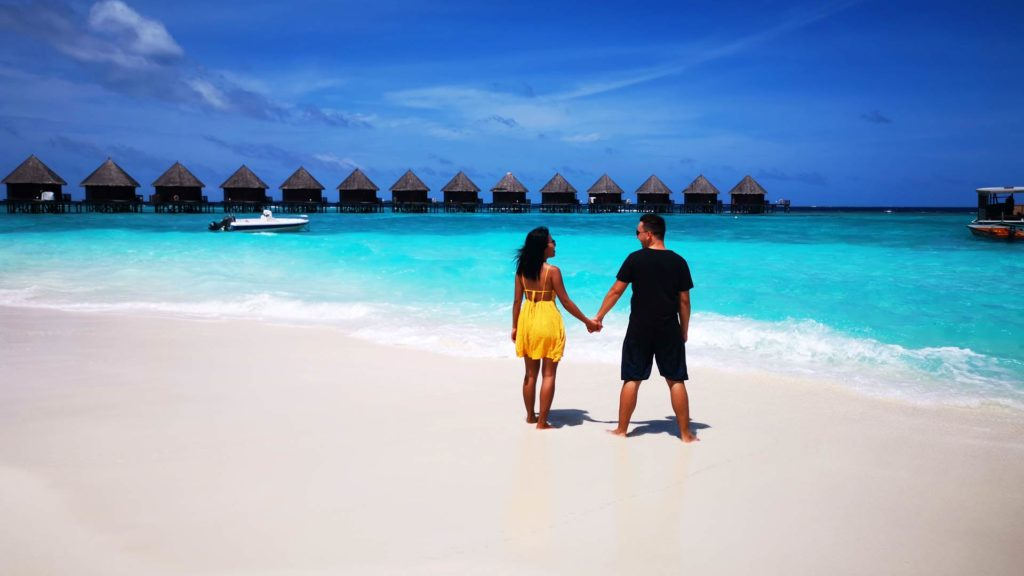 Marcel and his wife on the beach of Thulhagiri Island, Maldives