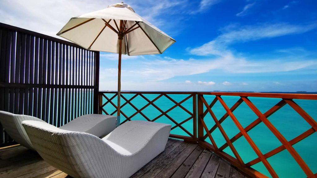 Terrace overlooking the sea in the water villas of Thulhagiri Island Resort