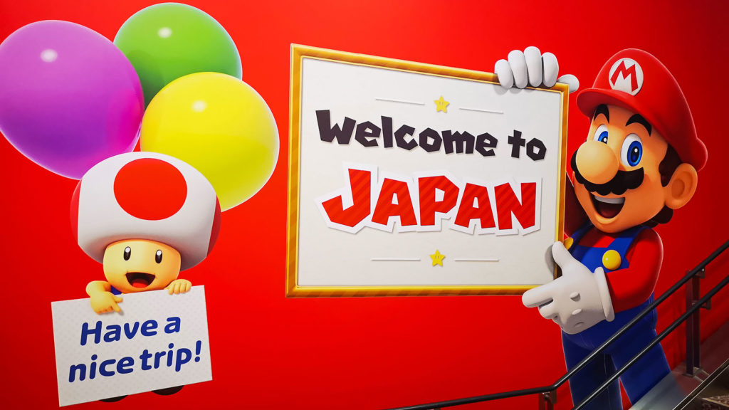 Mario begrüßt Gäste mit Welcome to Japan in Tokio