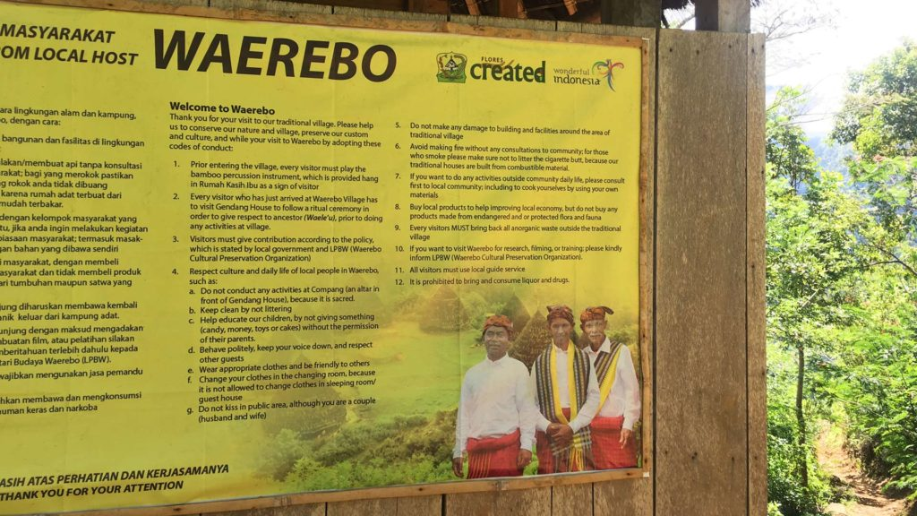 Info board with the rules of conduct in Wae Rebo village