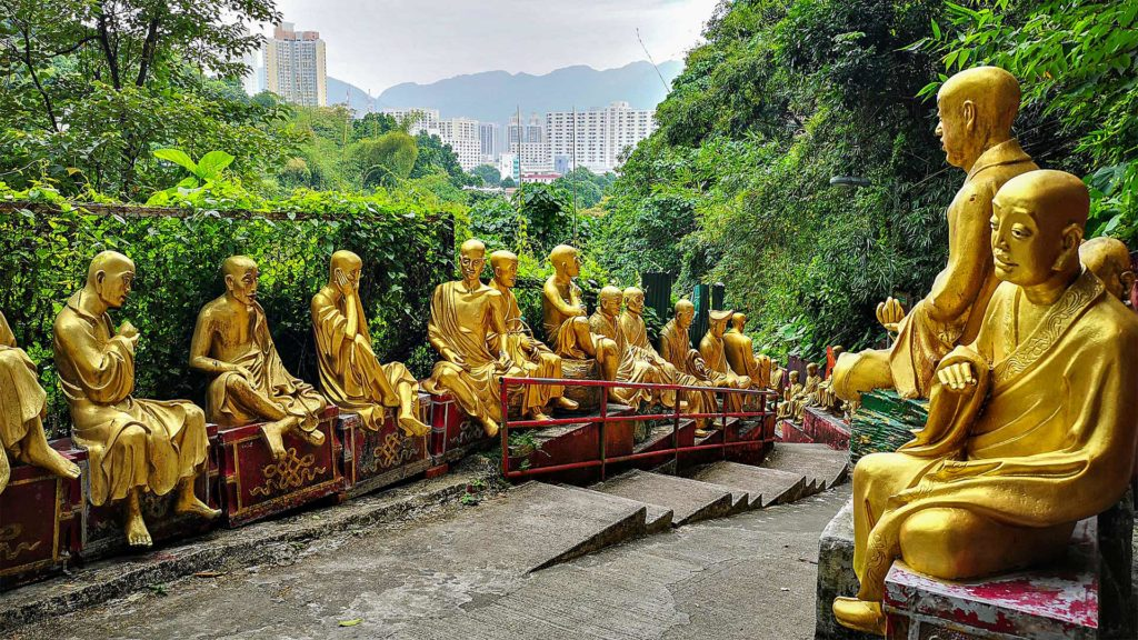 View of the Buddha statues and the Hong Kong skyline