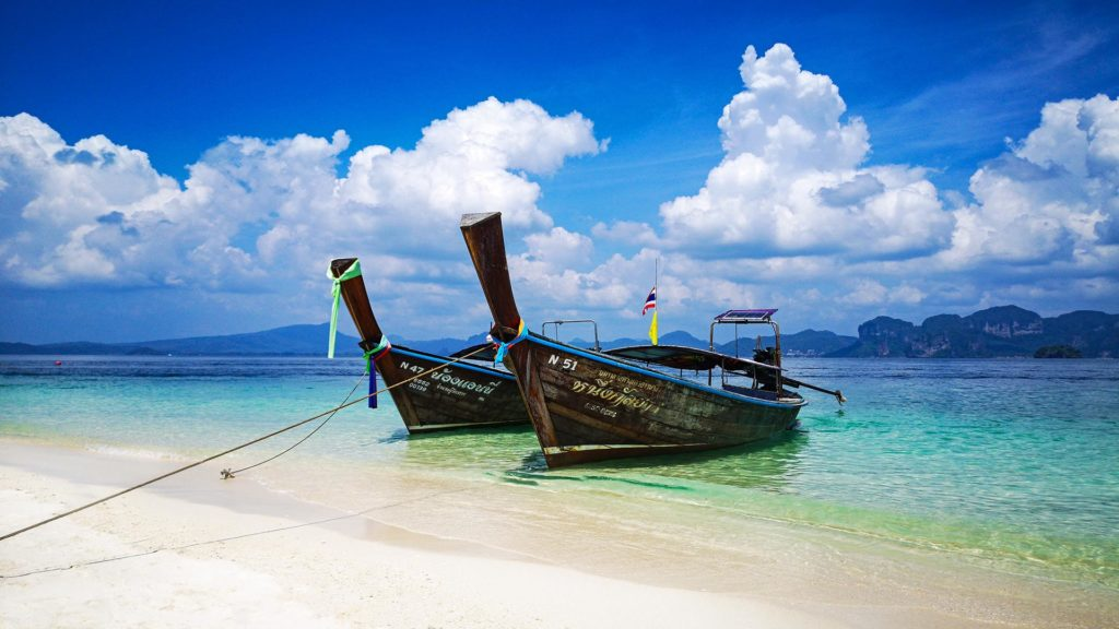 Longtail boat on the beach of Koh Poda during the Krabi 4 Island Tour